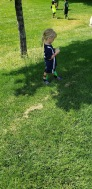 waiting for her turn at soccer